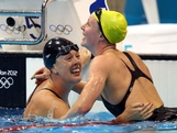 Allison Schmitt (L) of the United States is congratulated by Bronte Barratt of Australia after winning gold in the Women's 200m Freestyle final on Day 4 of the London 2012 Olympic Games at the Aquatics Centre on July 31, 2012 in London, England.