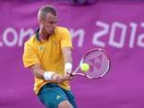 Lleyton Hewitt of Australia returns a shot to Marin Cilic of Croatia during the second round of Men's Singles Tennis on Day 4 of the London 2012 Olympic Games at Wimbledon on July 31, 2012 in London, England.