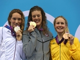 (L-R) Silver medallist Camille Muffat of France, gold medallist Allison Schmitt of the United States and bronze medallist  Bronte Barratt of Australia pose on the podium during the medal ceremony for the Women's 200m Freestyle final on Day 4 of the London 2012 Olympic Games at the Aquatics Centre on July 31, 2012 in London, England.