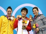 Silver medallist Alicia Coutts of Australia, gold medallist Shiwen Ye of China and bronze medallist  Caitlin Leverenz of the USA pose on the podium during the medal ceremony during the medal ceremony in the Women's 200m Individual Medley final on Day 4 of the London 2012 Olympic Games at the Aquatics Centre on July 31, 2012 in London, England.