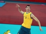 Adam White #9 of Australia spikes the ball in the third set against Great Britain during Men's Volleyball on Day 4 of the London 2012 Olympic Games at Earls Court on July 31, 2012 in London, England.