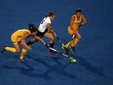 Celine Wilde (C) of Germany attempts to break through the Australia defense during the Women's Hockey Match between Germany and Australia on day 4 of the London 2012 Olympic Games at Riverbank Arena on July 31, 2012 in London, England.