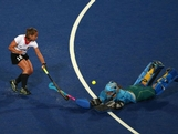 Lisa Hahn of Germany (L) tries to chip the goalkeeper Toni Cronk of Australia during the Women's Hockey Match between Germany and Australia on day 4 of the London 2012 Olympic Games at Riverbank Arena on July 31, 2012 in London, England.