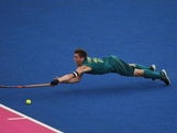 Captain Edward Ockenden of Australia stretches for the ball during the Men's preliminary Hockey match on Day 5 of the London 2012 Olympic Games at Riverbank Arena on August 1, 2012 in London, England.