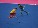 Russell Ford of Australia hits past Ramon Allegre of Spain on Day 5 of the London 2012 Olympic Games at Riverbank Arena on August 1, 2012 in London, England.