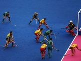 Russell Ford of Australia shoots for goal on Day 5 of the London 2012 Olympic Games at Riverbank Arena on August 1, 2012 in London, England.