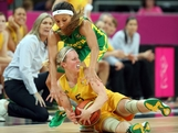 Samantha Richards #5 of Australia attempts to control a loose ball under pressure from Adriana Pinto #4 of Brazil during the Women's Basketball Preliminary Round match on Day 5 of the London 2012 Olympic Games at Basketball Arena on August 1, 2012 in London, England.