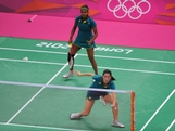 Leanne Choo (R) and Renuga Veeran (L) of Australia return against Alex Bruce and Michelle Li of Canada in their Women's Doubles Badminton on Day 5 of the London 2012 Olympic Games at Wembley Arena at Wembley Arena on August 1, 2012 in London, England.