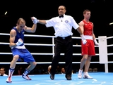 Detelin Dalakliev of Bulgaria (L) celebrates his victory over Ibrahim Balla of Australia during the Men's Bantam (56kg) Boxing on Day 5 of the London 2012 Olympic Games at ExCeL on August 1, 2012 in London, England.