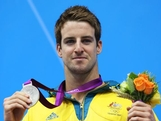 Silver medalist James Magnussen of Australia celebrates with his medal on the podium during the medal cermony for the Men's 100m Freestyle on Day 5 of the London 2012 Olympic Games at the Aquatics Centre on August 1, 2012 in London, England.