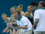 Australian players and coach Greg McFadden show their support in the Women's Preliminary Round Water Polo match between Great Britain and Australia on Day 5 of the London 2012 Olympics at Water Polo Arena on August 1, 2012 in London, England.