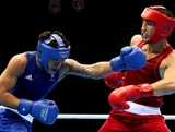 Teymur Mammadov of Azerbeijan (R) in action with Jai Tapu Opetaia of Australia during the Men's Heavy (91kg) Boxing on Day 5 of the London 2012 Olympic Games at ExCeL on August 1, 2012 in London, England.