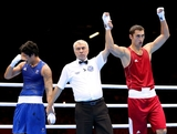 Teymur Mammadov of Azerbeijan (R) celebrates his victory over Jai Tapu Opetaia of Australia during the Men's Heavy (91kg) Boxing on Day 5 of the London 2012 Olympic Games at ExCeL on August 1, 2012 in London, England.