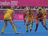 Keli Smith-Puzo of the United States competes with Kobie Mcgurk of Australia during the Women's Hockey preliminary match between Australia and United States on Day 6 of the London 2012 Olympic Games at Riverbank Arena on August 2, 2012 in London, England.
