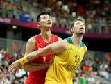 David Andersen #13 of Australia boxes out Jianlian Yi #11 of China in the second half during the Men's Basketball Preliminary Round match on Day 6 of the London 2012 Olympic Games at Basketball Arena on August 2, 2012 in London, England.