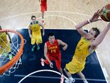 Joe Ingles #7 of   Australia goes over Wang Zhizhi of China during the Men's Basketball Preliminary Round on Day 6 of the London 2012 Olympic Games at Basketball Arena on August 2, 2012 in London, England.