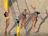 Becchara Palmer of Australia is blocked by Talita Rocha of Brazil during the Women's Beach Volleyball preliminary match between Brazil and Australia on Day 6 of the London 2012 Olympic Games at Horse Guards Parade on August 2, 2012 in London, England.