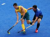 Matt Ghodes of Australia battles with Pedro Ibarra of Argentina during the Men's Hockey preliminary match between Australia and Argentina on Day 7 of the London 2012 Olympic Games at Riverbank Arena on August 3, 2012 in London, England