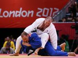 Christopher Sherrington of Great Britain (white) and Jake Andrewartha of Australia compete in the Men's +100 kg Judo on Day 7 of the London 2012 Olympic Games at ExCeL on August 3, 2012 in London, England.