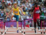 L-R) Tristan Thomas of Australia and Kerron Clement of the United States compete in the Men's 400m Hurdles Heats on Day 7 of the London 2012 Olympic Games at Olympic Stadium on August 3, 2012 in London, England.
