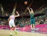 Belinda Snell #12 of Australia puts up  a three point shot over Nadezhda Grishaeva #15 of Russia during the Women's Basketball Preliminary Round match on Day 7 of the London 2012 Olympic Games at Basketball Arena  on August 3, 2012 in London, England.
