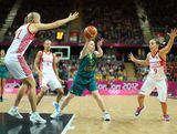 Kristi Harrower #10 of Australia passes the ball under pressure from Becky Hammon #9 of Russia during the Women's Basketball Preliminary Round match on Day 7 of the London 2012 Olympic Games at Basketball Arena  on August 3, 2012 in London, England.