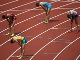 (L-R) Kyle Alcorn of the United States, Youcef Abdi of Australia, Artem Kosinov of Kazakhstan and Vincent Zouaoui-Dandrieux of France rest after competing in the Men's 3000m Steeplechase Heats on Day 7 of the London 2012 Olympic Games at Olympic Stadium on August 3, 2012 in London, England.