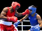 Custio Clayton of Canada (L) in action with Cameron Hammond of Australia during the Men's Welter (69kg) Boxing on Day 7 of the London 2012 Olympic Games at ExCeL on August 3, 2012 in London, England.