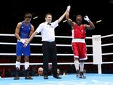 Custio Clayton of Canada (R) celebrates his victory over Cameron Hammond of Australia during the Men's Welter (69kg) Boxing on Day 7 of the London 2012 Olympic Games at ExCeL on August 3, 2012 in London, England.