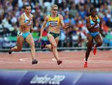 Guzel Khubbieva of Uzbekistan, Melissa Breen of Australia and Debbie Ferguson-Mckenzie of the Bahamas compete in the  Women's 100m Round 1 Heats on Day 7 of the London 2012 Olympic Games at Olympic Stadium on August 3, 2012 in London, England.