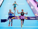 Lisa Norden of Sweden (L), Nicola Spirig of Switzerland (R), and Erin Densham of Australia finish the Women's Triathlon on Day 8 of the London 2012 Olympic Games at Hyde Park on August 4, 2012 in London, England.