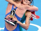 Erin Densham of Australia (R) hugs Lisa Norden of Sweden after the Women's Triathlon on Day 8 of the London 2012 Olympic Games at Hyde Park on August 4, 2012 in London, England.