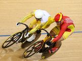 Shane Perkins (L) of Australia bumps with Hodei Mazquiaran Uria of Spain during Men's Sprint Track Cycling 1/16 Finals on Day 8 of the London 2012 Olympic Games at Velodrome on August 4, 2012 in London, England.