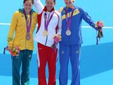 Silver medalist Lisa Norden of Sweden, Gold medalist Nicola Spirig of Switzerland, and Bronze medalist Erin Densham of Australia pose with their medals after the Women's Triathlon on Day 8