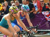 Erin Densham (L) of Australia and Jessica Harrison of France compete in the Women's Triathlon on Day 8 of the London 2012 Olympic Games at Hyde Park on August 4, 2012 in London, England.