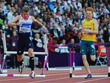Jack Green of Great Britain (L) trips as he and Tristan Thomas of Australia compete in the Men's 400m Hurdles Semi Final on Day 8 of the London 2012 Olympic Games at Olympic Stadium on August 4, 2012 in London, England.