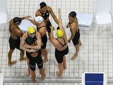 Alicia Coutts, Emily Seebohm and Leisel Jones of Australia embrace Aya Terakawa, Satomi Suzuki, Yuka Kato, and Haruka Ueda of Japan following the Women's 4x100m Medley Relay Final on Day 8 of the London 2012 Olympic Games at the Aquatics Centre on August 4, 2012 in London, England.