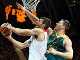 Joel Freeland #11 of Great Britain puts up a shot past Aron Baynes #12 of Australia during the Men's Basketball Preliminary Round match on Day 8 of the London 2012 Olympic Games at the Basketball Arena on August 4, 2012 in London, England.