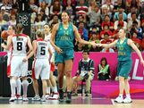 LONDON, ENGLAND - AUGUST 05:  Liz Cambage #14 of Australia is congratulated by Kristi Harrower #10 after Cambage scored against Canada during the Women's Basketball Preliminary Round match on Day 9 of the London 2012 Olympic Games at the Basketball Arena on August 5, 2012 in London, England.