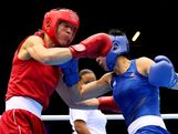 Anna Laurell of Sweden (L) in action with Naomi-Lee Fischer-Rasmussen of Australia during the Women's Middle (69-75kg) Boxing on Day 9 of the London 2012 Olympic Games at ExCeL on August 5, 2012 in London, England.