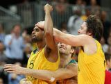 Patrick Mills #5 of Australia celebrates with teammates after making the game winning three point shot against Russia in the final seconds of the Men's Basketball Preliminary Round match on Day 10 of the London 2012 Olympic Games at the Basketball Arena on August 6, 2012  in London, England.