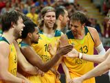 Patrick Mills #5 of Australia celebrates with David Barlow #10, David Andersen #13 and Joe Ingles #7 after making the game winning three point shot against Russia in the final seconds of the Men's Basketball Preliminary Round match on Day 10 of the London 2012 Olympic Games at the Basketball Arena on August 6, 2012  in London, England.