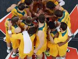 Members of the Australia team celebrate after defeating Russia in the Men's Basketball Preliminary Round match on Day 10 of the London 2012 Olympic Games at the Basketball Arena on August 6, 2012 in London, England.