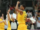 Patrick Mills #5 of Australia celebrates after making the game winning three point shot against Russia in the final seconds of the Men's Basketball Preliminary Round match on Day 10 of the London 2012 Olympic Games at the Basketball Arena on August 6, 2012  in London, England.