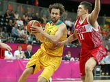 LONDON, ENGLAND - AUGUST 06:  Matt Nielsen #14 of Australia drives the ball past Semen Antonov #11 of Russia during the Men's Basketball Preliminary Round match on Day 10 of the London 2012 Olympic Games at the Basketball Arena on August 6, 2012  in London, England.
