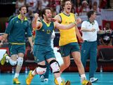 Aden Tutton #12 and the rest of the Australia bench runs out on the court after the match win over Poland during Men's Volleyball