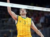 Nathan Roberts #3 of Australia sends the ball over the net against Poland during Men's Volleyball
