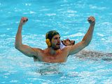 Rhys Howden #12 of Australia celebrates after scoring a goal, as  Emmanouil Mylonakis #2 of Greece looks on during the Men's Preliminary Round Group A match between Greece and Australia on Day 10 of the London 2012 Olympic Games at Water Polo Arena on August 6, 2012 in London, England.