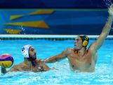Aaron Younger (R) #5 of Australia defends against Evagelos Delakas #8 of Greece during the Men's Preliminary Round Group A match between Greece and Australia on Day 10 of the London 2012 Olympic Games at Water Polo Arena on August 6, 2012 in London, England.