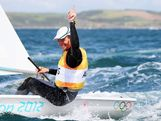 Tom Slingsby of Australia celebrates winning gold in the Men's Laser Sailing on Day 10 of the London 2012 Olympic Games at the Weymouth & Portland Venue at Weymouth Harbour on August 6, 2012 in Weymouth, England.